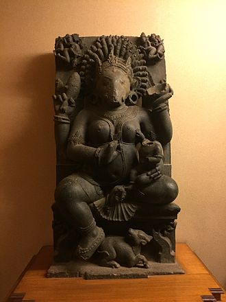 Varahi - Four-armed Varahi sculpture made of black chlorite stone in Odisha State Museum.