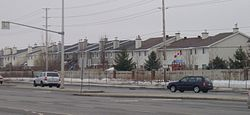 A group of homes in Barrhaven on Woodroffe Avenue, between Fallowfield Road and Earl Mulligan Drive