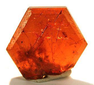 Bastnäsite - Bastnäsite crystal, Zagi Mountain, Federally Administered Tribal Areas, Pakistan. Size: 1.5×1.5×0.3 cm.