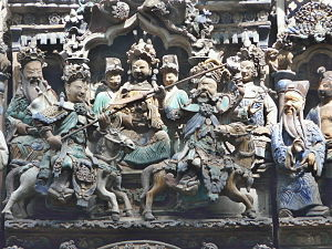 Thien Hau Temple (Ho Chi Minh City) - A scene from the roof of the temple shows actors depicting a duel between Guan Yu and another fighter.