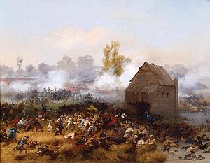 A wooden house, or possibly a mill, is surrounded by battle.  The smoke and haze of battle obscures much of the background, but formations of red-coated soldiers are visible through it.  Small figures, some clearly uniformed, others not obviously so, fight in the foreground.
