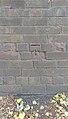 Benchmark on Bromborough Road south of railway bridge.jpg