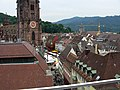 Blick von der Dachterrasse Kaiser-Joseph-Straße 192 in Freiburg zum Münster und Schwabentor.jpg
