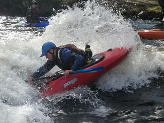 Playboating - Paddler performs a blunt on the Café Wave, Canolfan Tryweryn.