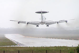 Crosswind - In a crosswind landing, the fuselage of the plane may be skewed relative to the runway