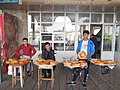 Bread sellers at the Chorsu Bazar.jpg