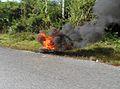 Burnin tire in Laos.JPG