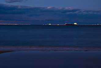 Chesapeake Bay Bridge–Tunnel - Cargo ships line up to cross the bridge–tunnel complex at night