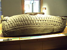 Photograph of a hogback sculpted tombstone