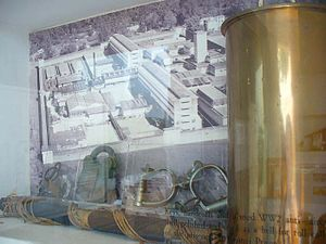 Selarang Barracks incident - A display of POW artefacts at the Changi Chapel and Museum. The picture in the background shows Changi Prison during World War II
