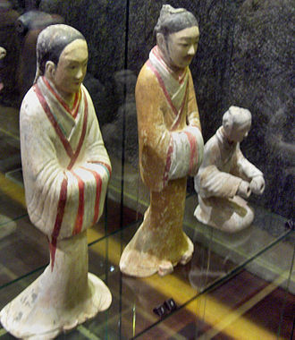 Han Chinese - A female servant and male advisor dressed in silk robes, ceramic figurines from the Western Han era