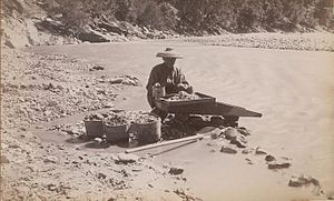 Chinese Man Mining Along River