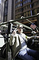 Chuck Wesson, an injured veteran, poses for a photo while riding in a Humvee during the annual St. Patrick's Day Parade 130316-A-MV865-005.jpg