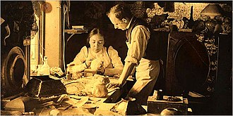 Clara Driscoll (glass designer) - Clara Driscoll in a workroom with Joseph Briggs, a longtime manager at Tiffany Studios (1901).