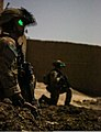 Coalition forces security force members perform security checks during an operation in the Khost district of Khost province, Afghanistan, Aug. 21, 2013 130821-A-HD451-026.jpg