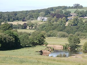 Colleton, Chulmleigh - Colleton Barton viewed from south west, showing the River Taw in the valley bottom