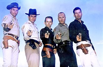 "Practical shooting - These men are five of the ""Combat Masters"", the five most successful shooters during the competitions held at the South Western Combat Pistol League (""SWCPL"") at Big Bear Lake, California, during the late Fifties. Left to right: Ray Chapman, Elden Carl, Thell Reed, Jeff Cooper, Jack Weaver. (The sixth ""Combat Master"", John Plahn, is missing from this photograph.)"