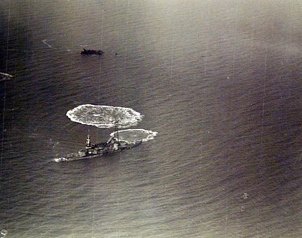 Aerial view of the damaged Indiana following aerial bombing tests