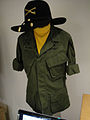 "Debbie Reynolds Auction - Robert Duvall ""Lt Col Kilgore"" tropical combat coat and signature yellow branch scarf from ""Apocalypse Now"".jpg"