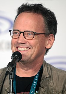 Dee Bradley Baker appearing at a convention in 2016.