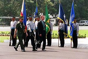 Camp Aguinaldo - GHQ Security Escort Battalion render honors for US Defense Secretary Cohen at the Camp Aguinaldo Grandstand and Parade Ground.