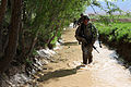 Defense.gov News Photo 100507-A-6285M-013 - U.S. Army soldiers conduct a dismounted patrol through a creek in the village of Babus in the Pol-e Alam district of Afghanistan on May 7, 2010.jpg