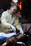 Defense.gov News Photo 100818-N-8907D-163 - U.S. Navy Petty Officer 2nd Class Justin Lamb a hospital corpsman assigned to the medical department aboard the aircraft carrier USS Harry S.jpg