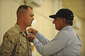 Defense.gov News Photo 110710-F-RG147-940 - Secretary of Defense Leon E. Panetta awards U.S. Marine Shawn Vernon Combat Logistics Battalion-7 the Purple Heart at Camp Dwyer Afghanistan on.jpg