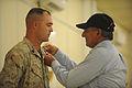 Defense.gov News Photo 110710-F-RG147-940 - Secretary of Defense Leon E. Panetta awards U.S. Marine Shawn Vernon Combat Logistics Battalion-7 the Purple Heart at Camp Dwyer Afghanistan on.jpg