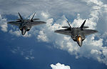 Defense.gov News Photo 120710-F-JQ435-043 - Two U.S. Air Force F-22 Raptor aircraft fly behind a KC-135 Stratotanker aircraft after receiving fuel over Joint Base Andrews Md. on July 10.jpg