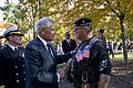 Defense Secretary Chuck Hagel shakes hands with a Vietnam War veteran after a Veterans Day ceremony at the Vietnam Veterans Memorial in Washington, D.C 141111-D-AF077-523c.jpg