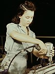 Detail, Drilling a wing bulkhead for a transport plane at the Consolidated Aircraft Corporation1a34933v (cropped).jpg