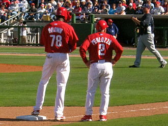 Domonic Brown - During 2010 spring training, Brown converses with third base coach Sam Perlozzo.