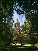 Notre Dame Golden Dome through the trees