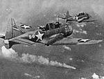 Douglas SBD-3 Dauntless bombers of VS-8 over the burning Japanese cruiser Mikuma on 6 June 1942.jpg