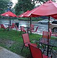 Edison NJ outside The Coffee House pouring rain red umbrellas and chairs.JPG