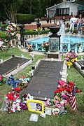 Photograph of Elvis Presley's grave at Graceland, with flowers.