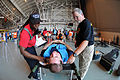 Emergency medical services providers triage a simulated patient in a 105th Airlift Wing hangar during the National Disaster Medical System (NDMS) exercise Golden Eagle III at Stewart Air National Guard Base 130601-Z-GJ424-054.jpg