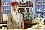 Emirates flight attendant in the Airbus A380 bar.jpg