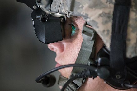 A Missouri National Guard member looking into a VR training headset at Fort Leonard Wood in 2015 Engineers train in virtual environment to prepare for real missions 150616-Z-YF431-084.jpg
