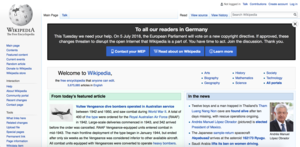"Screenshot of the top-half of the English Wikipedia main page with the banner ""To all our readers in Germany"" at the top"