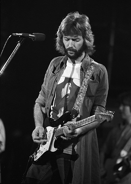 English guitarist, singer, and songwriter Eric Clapton is the only three-time inductee to the Rock and Roll Hall of Fame Eric-Clapton 1975.jpg