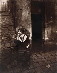 Eugène Atget - La Villette. Rue Asselin, prostitute waiting in front of her door - Google Art Project.jpg