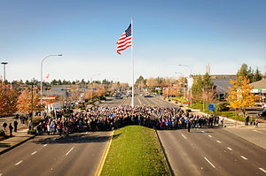Federal Way, Washington - November 11, 2014 Dedication of Downtown Flag and Veterans Way.  Flag raised by U.S. Senator Patty Murray, King County Councilmember Pete von Reichbauer, Mayor Jim Ferrell, City Council, Bob Kellogg and hundreds of community members.