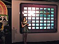 Female promotional model and 56 iPads screen at FunTown Mahjong press conference 20110426.jpg