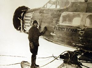 "Dean Smith (pilot) - Engineer Elbert J. Thawley standing beside the ""Floyd Bennett"" airplane"