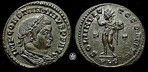 """Coin of Constantine, with depiction of the sun god Sol Invictus, holding a globe and right hand raised. The legend on the reverse reads SOLI INVICTO COMITI, to (Constantine's) """"companion, the unconquered Sol""""."""