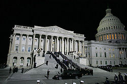 Military pallbearers carry the casket of former President Gerald R. Ford up the East Steps of the Capitol Building, December 30, 2006