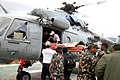 French and Polish Rescue team with Nepalese Army are boarding quake-affected injured persons in IAF Helicopters, at Melanchi, in Nepal.jpg