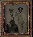Full length, two young men with straw hats, seated beside each other. Cased tintype, sixth plate.jpg